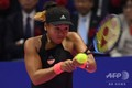 女子テニス、東レ・パンパシフィック・オープン、シングルス決勝。リターンを打つ大坂なおみ(2018年9月23日撮影)。(c)Toshifumi KITAMURA / AFP